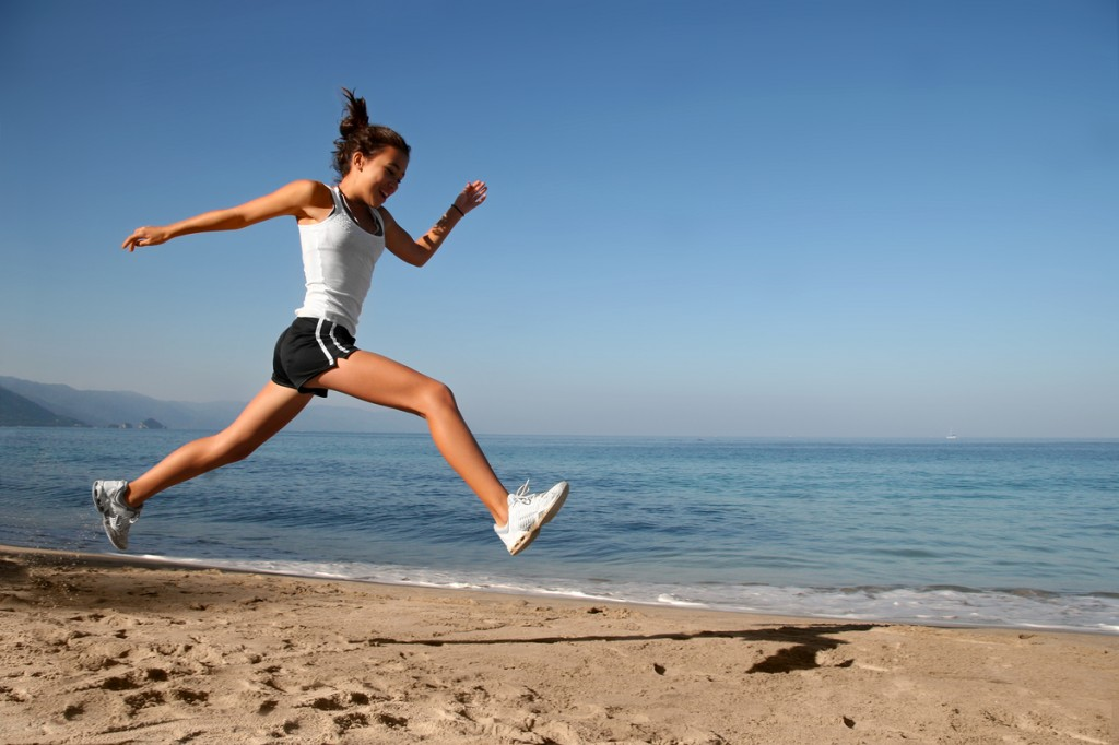 Woman-Running-on-Beach
